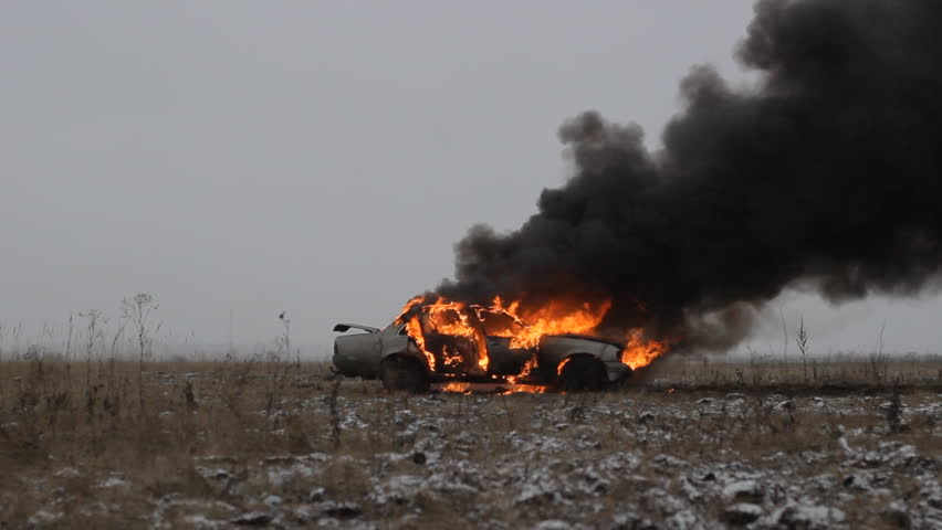Car on fire on the field. Sedan car. Side view   Shutterstock HD Video #10258118