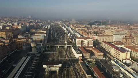 Aerial view of Bologna Centrale railroad station within cityscape, Italy