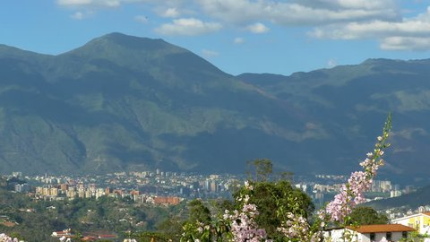 Panning view of Caracas city Valley with El Avila mountain,Venezuela. With a population of more than 4 million people is a sprawling metropolis choked with traffic and violence. Cerro El Avila.