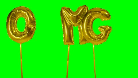 Word OMG from helium golden balloon letters floating on green screen