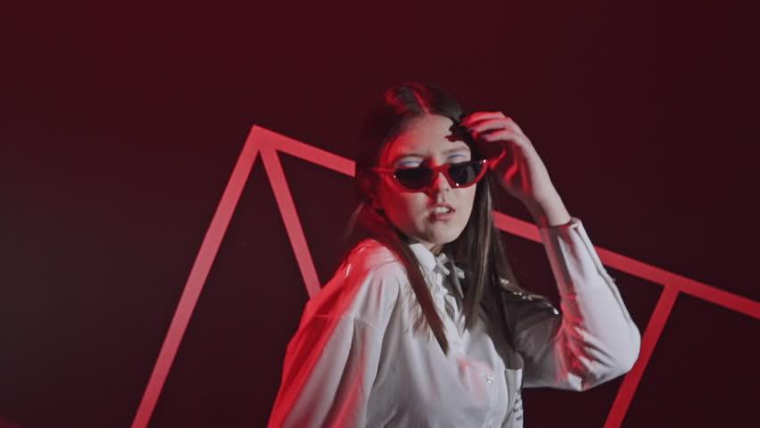 Beautiful girl dance in retro wave on the neon light. | Shutterstock HD Video #1025887811