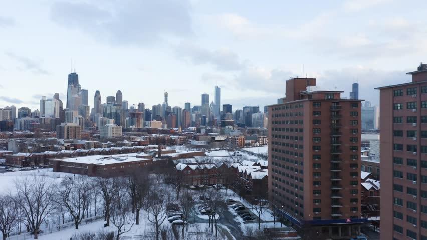 4k Winter Aerial of Chicago Skyline during sunset