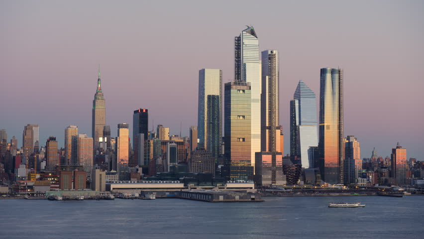 The mixed-use Hudson Yards real estate development and other buildings on the West Side of Manhattan in New York City at sunset. | Shutterstock HD Video #1025889521