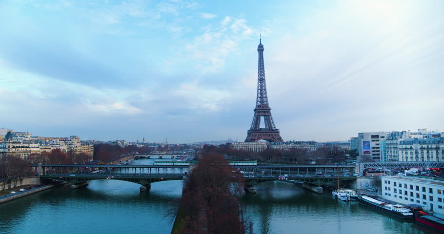 Drone shot going up of the Eiffel Tower on a cloudy day | Shutterstock HD Video #1025932661