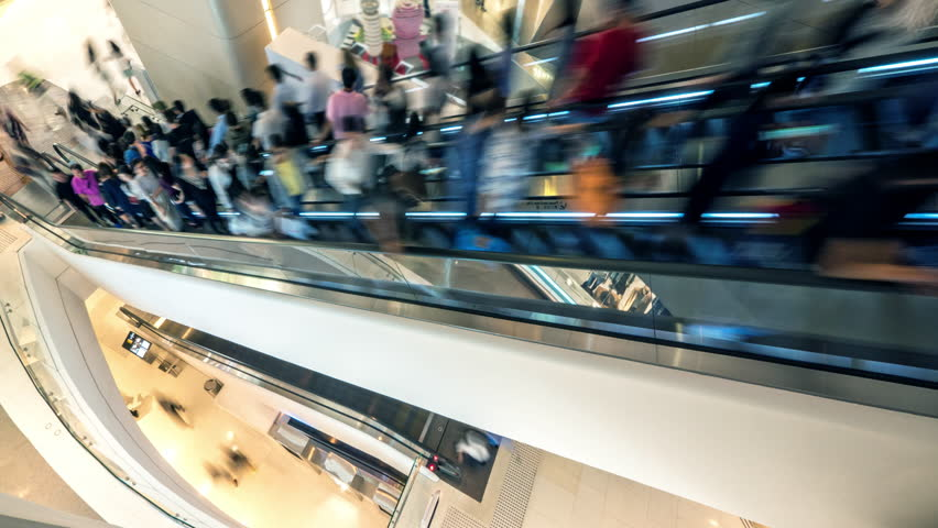 Abstract blurred scene of moving people on escalator in shopping mall in Asia   Shutterstock HD Video #1025936201