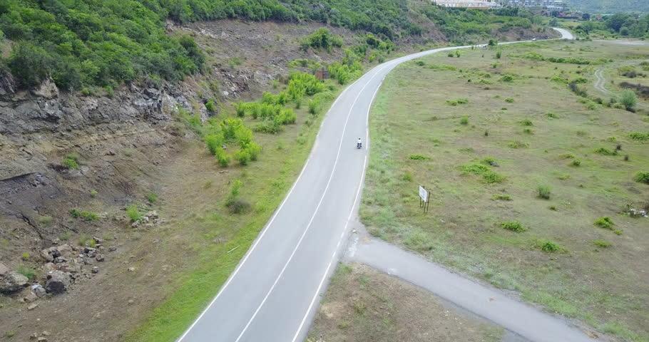 Drone camera following a biker in a highway | Shutterstock HD Video #1025963981
