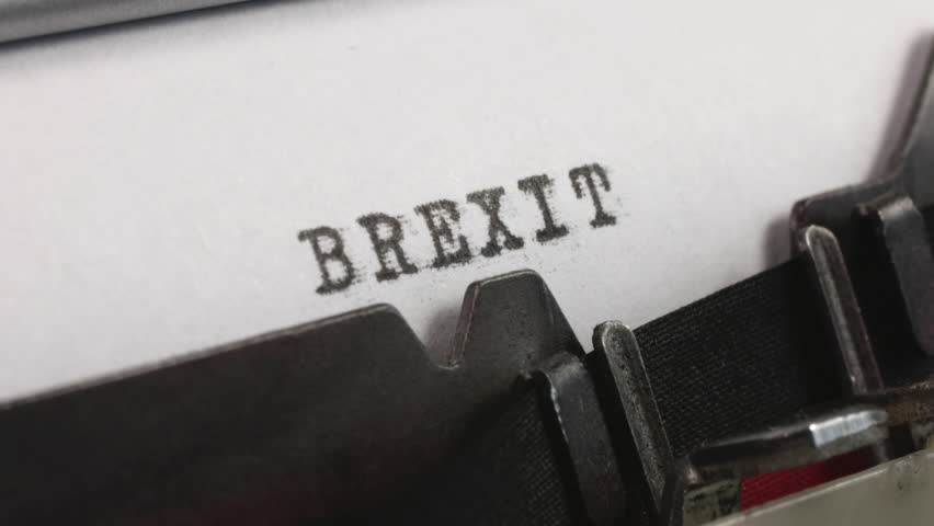 Typing BREXIT on an old manual typewriter. | Shutterstock HD Video #1025977091