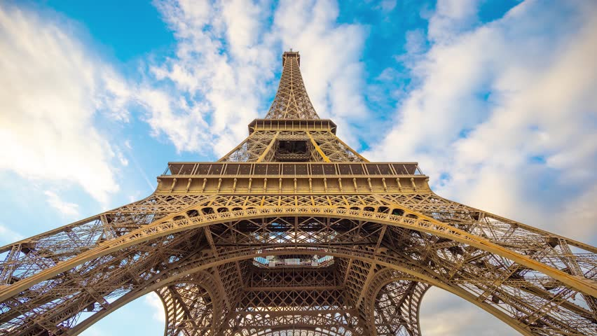 The Eiffel Tower Time lapse 10 seconds 4K Clouds and elevators Paris France Europe | Shutterstock HD Video #1026047291