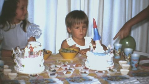 USA CIRCA 1971: Table Decorated With Two Birthday Cakes