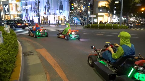 Tourist Cosplayers Driving Mario Go-Karts in Streets of Tokyo, Japan - September, 2018