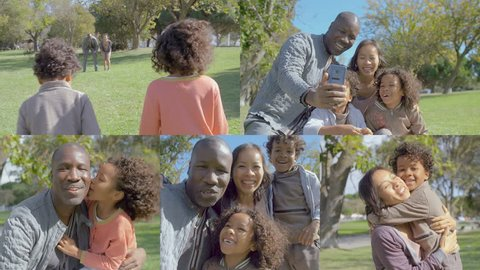 Afro-american young bald father sitting on haunches in park, making selfie of his family with kids, mother waving hand, kissing children. Family, holiday concept