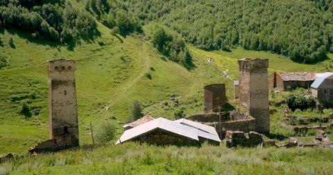 Pan across  stone medieval fortified Svaneti tower houses of Murkmeli,  near Ushguli, Upper Svaneti, Samegrelo-Zemo Svaneti, Mestia, Georgia.