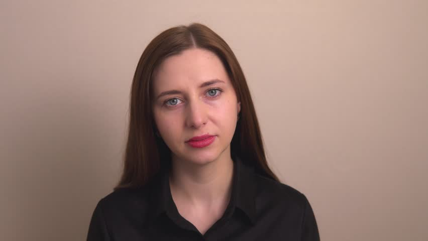 Portrait of a young woman against the wall | Shutterstock HD Video #1026293651