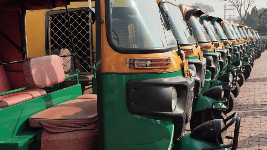 Indian taxi rickshaws exposed in a row. | Shutterstock HD Video #1026294221