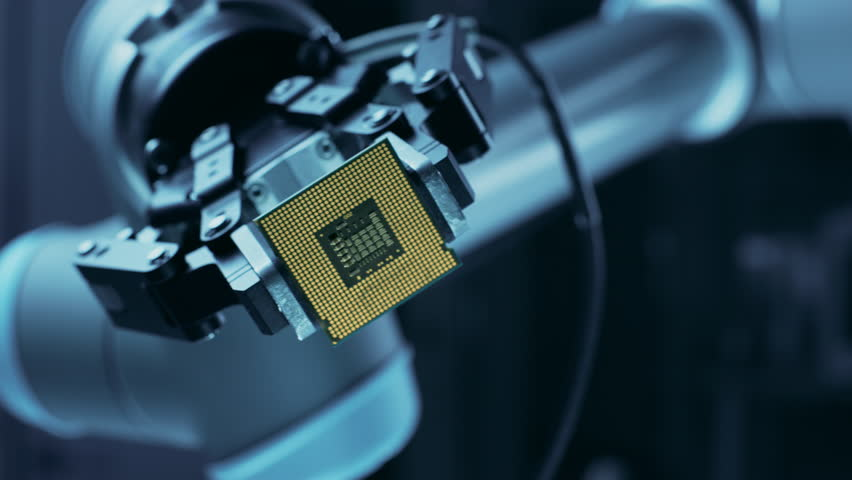 Modern High Tech Authentic Robot Arm Holding Contemporary Super Computer Processor Smoothly Moving into Focus. Industrial Robotic Manipulator End Effector Holding CPU Chip Moves Towards Camera Focus   Shutterstock HD Video #1026344651