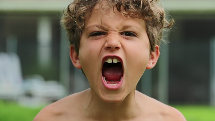 Child boy screaming from top of his lungs in slow-motion 120fps. Kid yelling roaring to camera | Shutterstock HD Video #1026369311