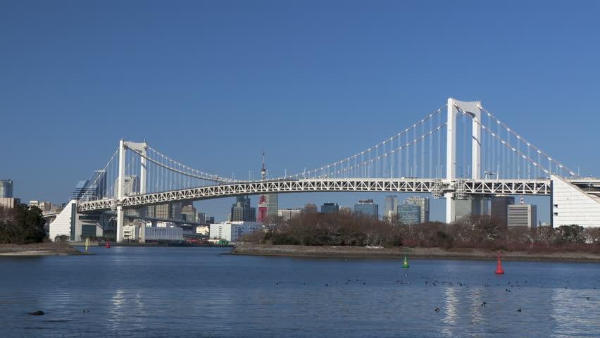 Rainbow bridge,  Urban landscape from Odaiba, Tokyo, Japan,   Shutterstock HD Video #1026425921