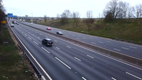Northamptonshire, UK - March 26 2019 -  Track over road traffic on the M1 smart four lane motorway with no hard shoulder and electronic active traffic management lanes in Northamptonshire England.