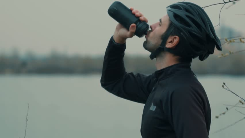 Cyclist Drinking Water From Water Bottle.Close-Up Slow Motion Cyclist Drinking.Athlete Cyclist Man Drinking Water After Cycling Biking Training. #1026481481