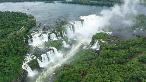 Aerial view of Iguazu Falls, monumental waterfalls on Iguazu River, Devil's Throat (Garganta del Diablo) waterfall - landscape panorama of Brazil/Argentina border, South America