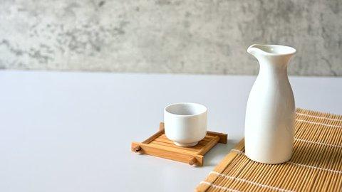 Asian men Pouring japanese sake oriental drink style Copy space