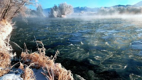 Icy Frost Rising From The Madison River In Ennis Montana On Cold Winter Day