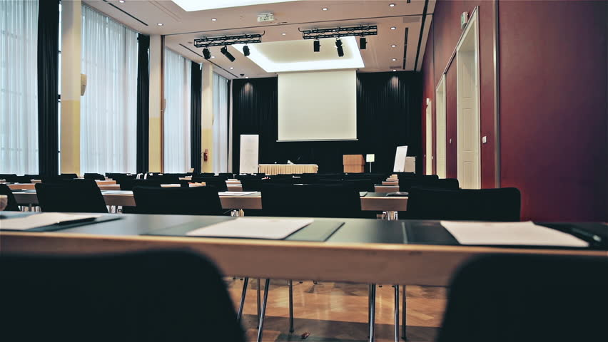 Empty lecture room. Dolly slide shot from behind empty seats with the board in focus. Nobody in the room. | Shutterstock HD Video #1026688781