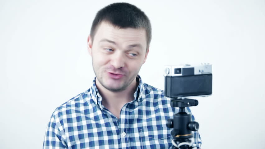 Young beautiful funny man blogger shooting blog or having video chat | Shutterstock HD Video #1026699581