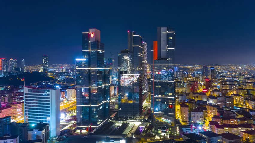 Business and finance area of Istanbul with highrises and shopping malls and commercial buildings at night. Istanbul, Turkey - Mart, 2019. Aerial drone Timelapse 4K | Shutterstock HD Video #1026761681