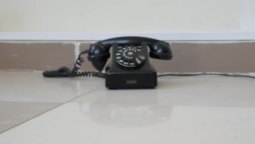 Old vintage telephone on the floor. Zoom in and zoom out old vintage telephone | Shutterstock HD Video #1026803681