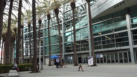 Anaheim, CA / USA - March 30, 2019: Conference attendees walking in the Palm Court of the Anaheim Convention Center