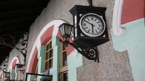 An old small train station. Station clock.