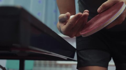 table tennis game serve concept. slow motion video. blurred focus on the grid. man playing training serve ball in table tennis the sport active lifestyle