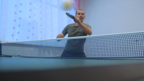 table tennis forehand concept. slow motion video. lifestyle blurred focus man playing training table tennis the sport active