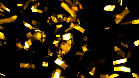 Ultra HD - 4K Realistic Golden Confetti, Party Popper on a Black Background .  Super Slow Motion , Realistic Video Background ... You can use blending mode (screen).