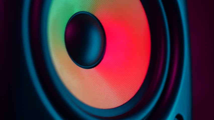 Close up of colorful loud bass speaker vibration on black background | Shutterstock HD Video #1026887471