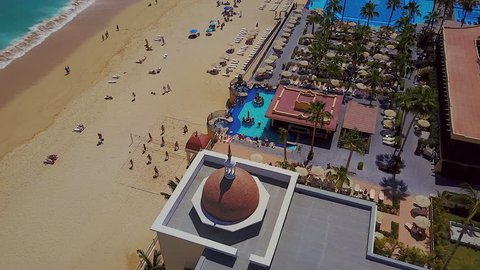 Drone fly over of a resort pool and beach in Cabo San Lucas Mexico. Footage was captured in 2018. 4K