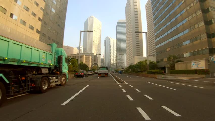 Urban Street with Skyscraper at Sunrise | Shutterstock HD Video #1026958301