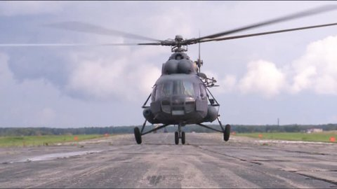 Military helicopter MI-8 takes off.