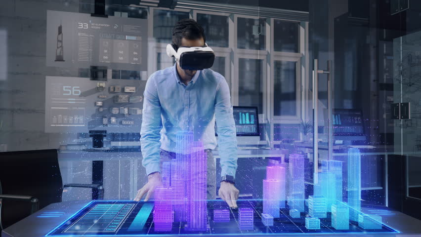 Professional Male Architect wearing Augmented Reality Headset makes gestures and redesigns 3D City Model. High Tech Office use Virtual Reality Modeling Software Application. | Shutterstock HD Video #1027004321
