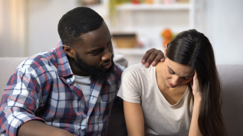 Afro-American man consoling his upset wife, health and life problems, support #1027129151