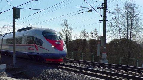 St. Petersburg, Russia, April 6, 2019: Fast trains Sapsan cross streak. High-speed train of Russian Railways.