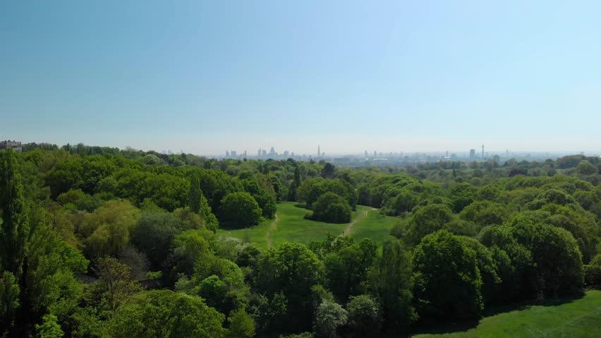 London skyline reveal over hampstead heath park aerial view sunny blue sky day summer | Shutterstock HD Video #1027207841