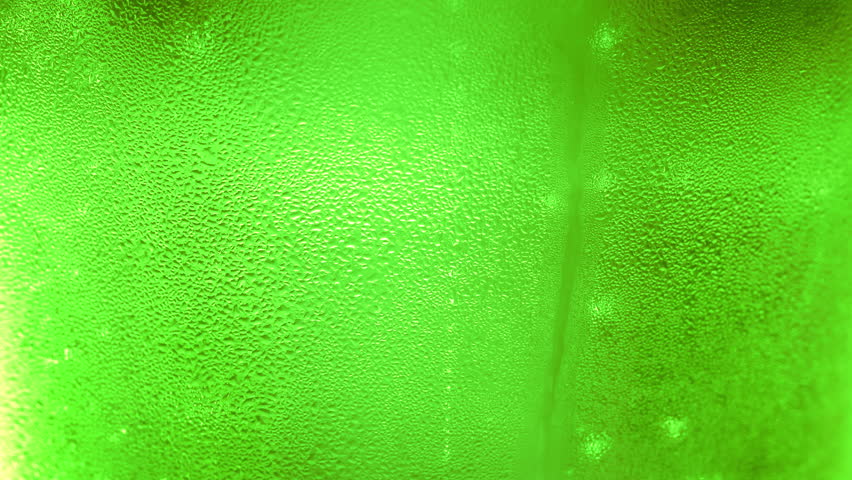 UHD macro of the green bottle of beer as a background | Shutterstock HD Video #1027237271