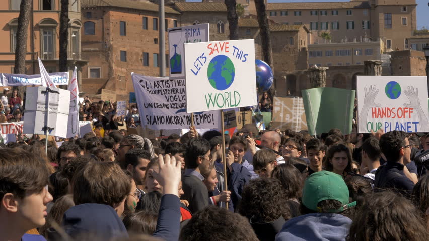 """Rome,Italy,15 March 2019: Global Climate Strike: """"Let's Save the World"""" banner"""