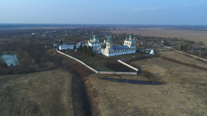 View of the old Nikolo-Vyazhischskiy Monastery, Sunny April evening (aerial video). Novgorod region, Russia