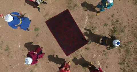 Old achers praying together, drone camera
