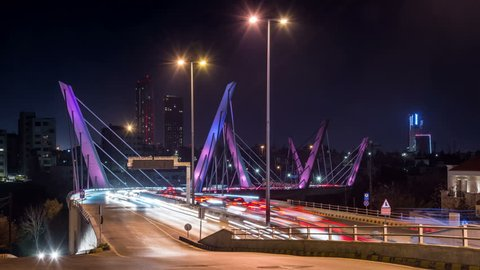 Illuminated Wadi Abdoun bridge at night, Amman, Jordan. Car traffic and light trails. Time lapse video.