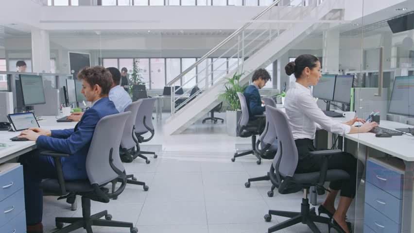 In Modern Office: Diverse Team of Managers and Specialists Work on Computer, Have Discussion with Colleagues and on the Phone. Young and Motivated Business people in Open Office.