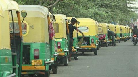Auto rickshaw drivers cleaning their auto rickshaw at an auto rickshaw stand near Pandav Nagar in New Delhi, India on 15.04.2019.